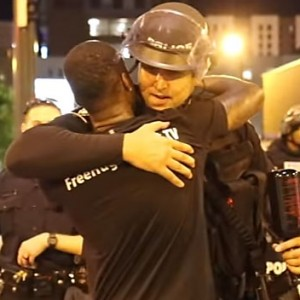 This Man Decided To Spread Peace During A Violent Protest In America By Giving Out Free Hugs