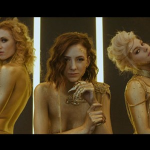 This Raunchy Ad For A Luxury Mansion Features Semi-Naked Models Dripping In Gold Paint