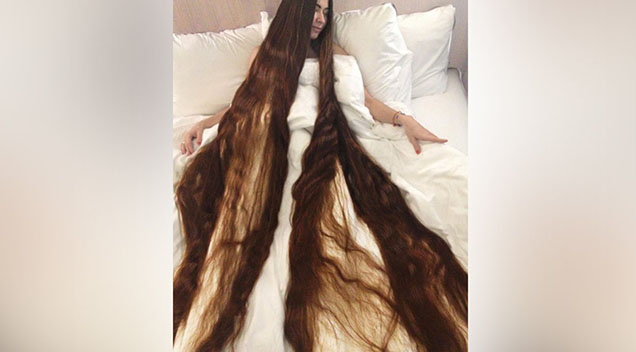 Aliia Nasyrova holding her 90 inch hair up on March 5