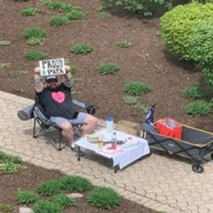 Husband Sets Up Epic 'Date Nights' Outside Pregnant Wife's Hospital Window As She Awaits Birth